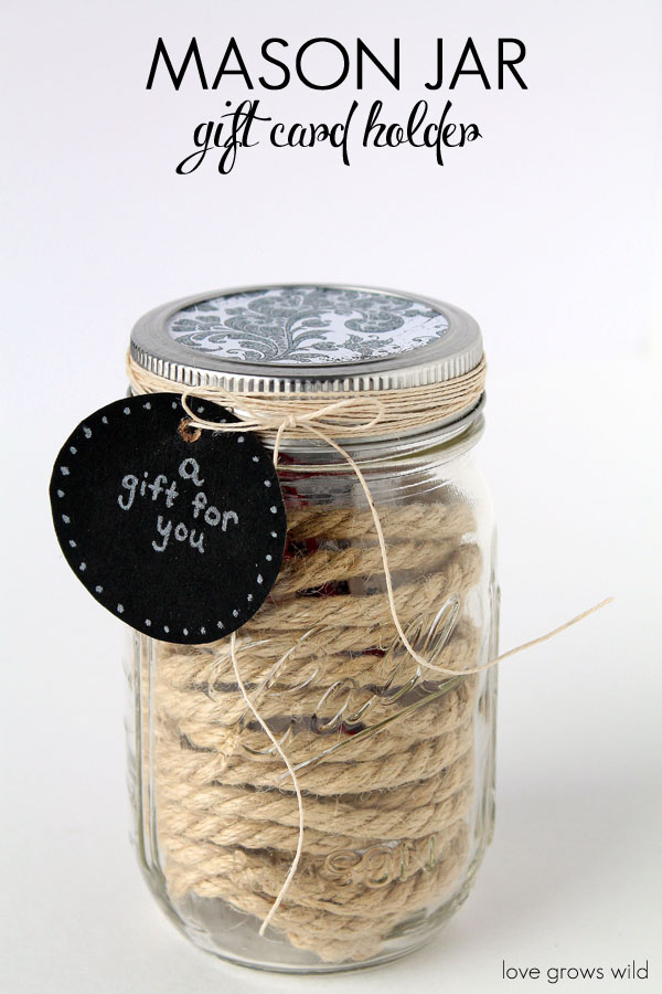 Dress up a mason jar as a unique way to give gift cards! This Mason Jar Gift Card Holder is perfect for the holidays!
