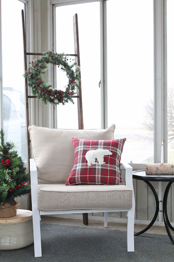 A warm and cozy rustic porch decorated for the holidays!