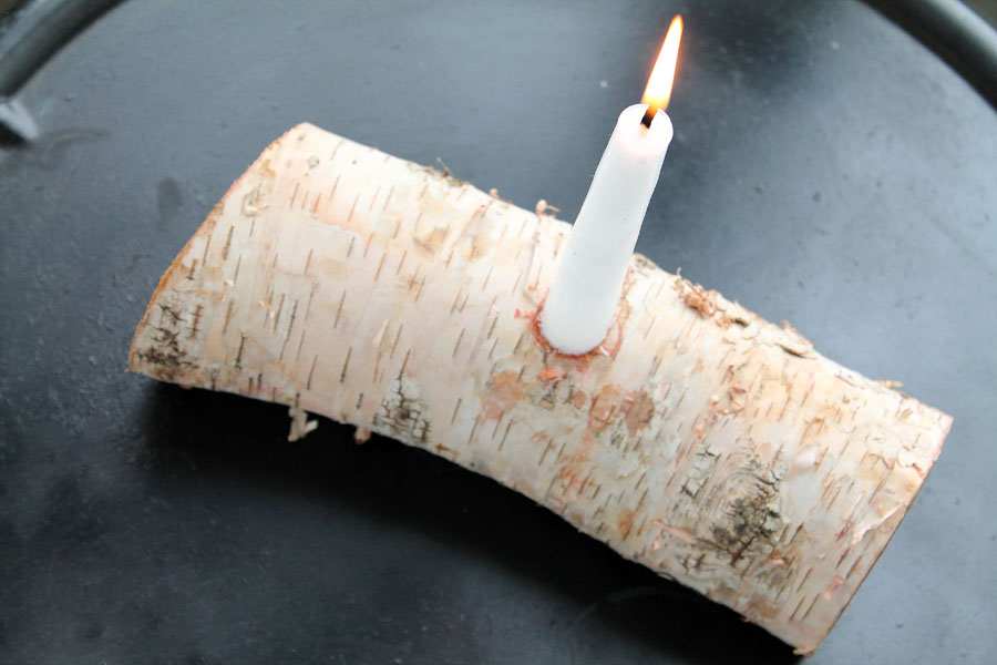 Cut a birch branch in half and drill a hole for a candle - perfect rustic decor!