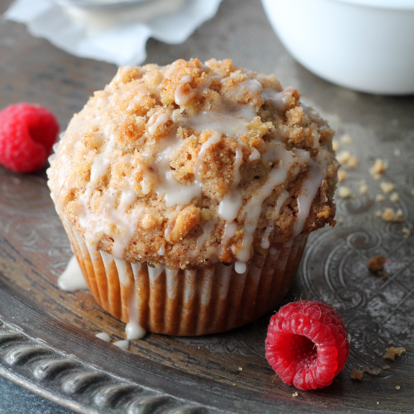 Coffee cake turned into a muffin! These Coffee Cake Muffins have a yummy fruity filling, crunchy cinnamon-walnut topping, and sweet vanilla glaze that makes them utterly delicious!