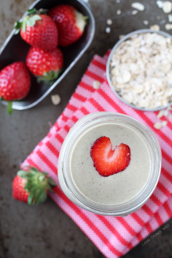 Strawberry Banana Oatmeal Smoothie - This super healthy smoothie will fill you up and keep you going all day long! So sweet and satisfying, you'll never know there's a big handful of vitamin-rich spinach hidden inside!