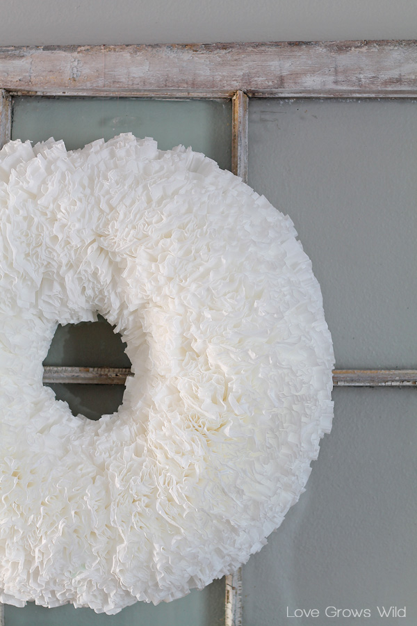 How to make a beautiful, ruffled Coffee Filter Wreath for easy and inexpensive home decor! Find the tutorial at LoveGrowsWild.com