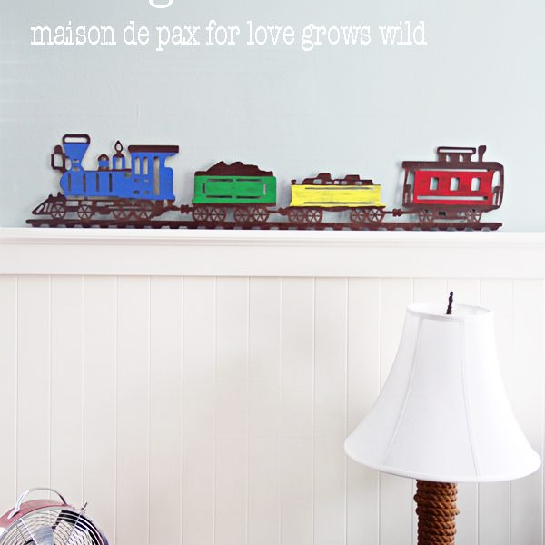 Add some craft paint to an old metal sign to create a fun statement piece!