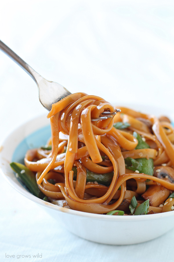 Have dinner on the table in LESS THAN 20 minutes! These Asian Noodles with Snow Peas and Mushrooms combine fresh, healthy ingredients and a flavorful homemade sauce in less time than it takes to boil the noodles! You MUST try this delicious Asian-inspired dish! LoveGrowsWild.com