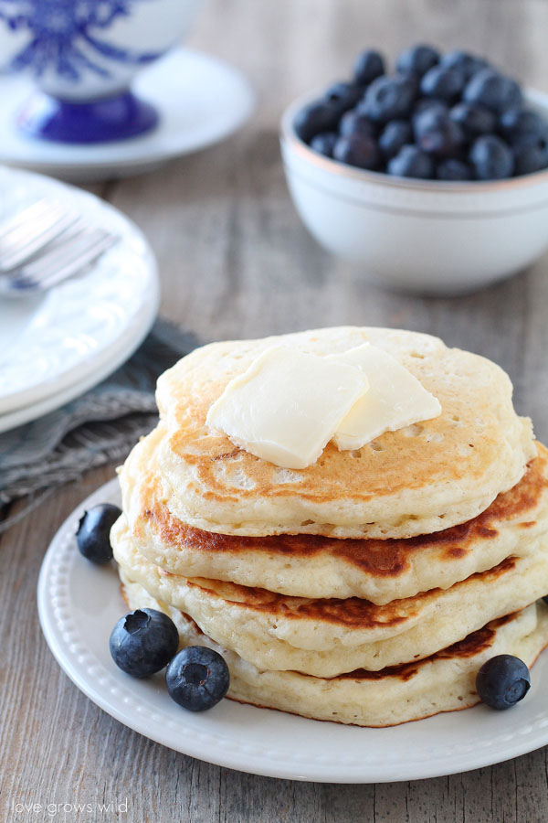 The BEST Buttermilk Pancake recipe! These pancakes are so light, fluffy, and tender!   LoveGrowsWild.com