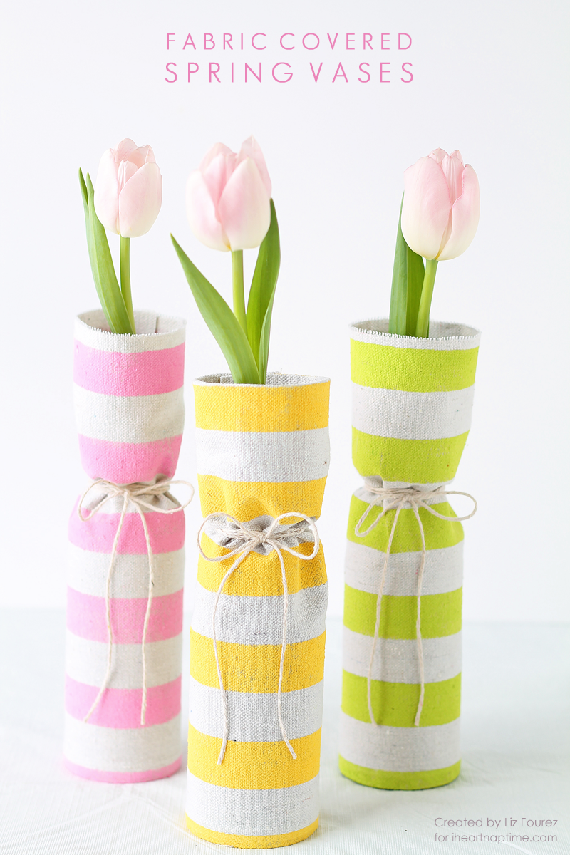 Use recycled bottles and a bit of fabric to create beautiful spring vases! A gorgeous way to display those spring flowers! | LoveGrowsWild.com