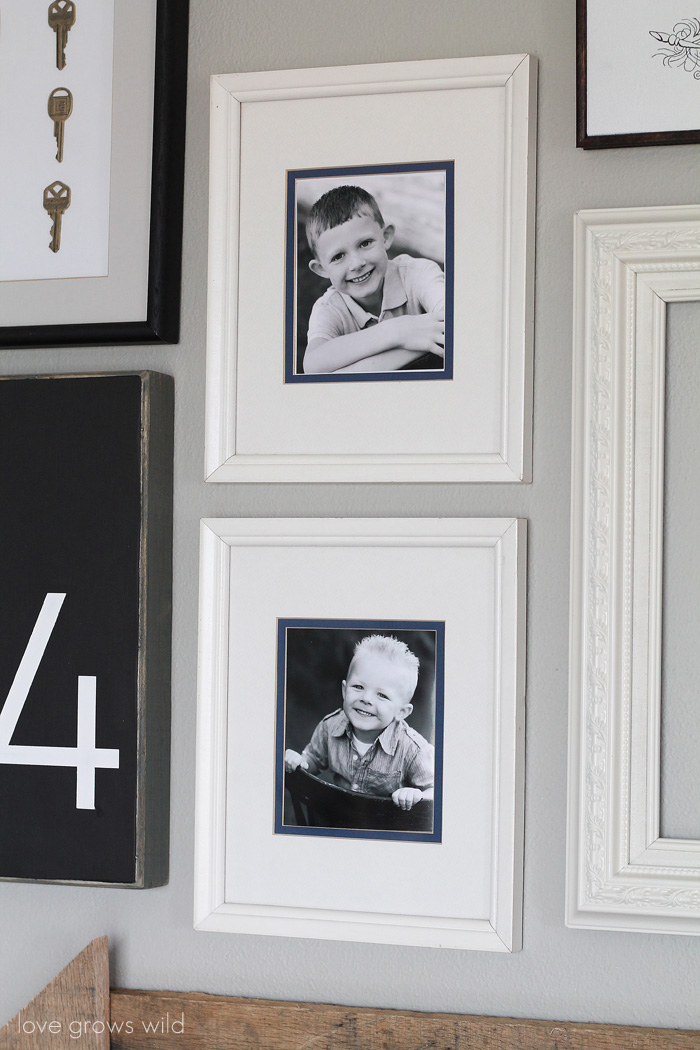Learn how to create a fun, personal, and creative Gallery Wall for LESS THAN $20! Yes, you CAN decorate an entire wall for that cheap! Get all the best tips and tricks from LoveGrowsWild.com