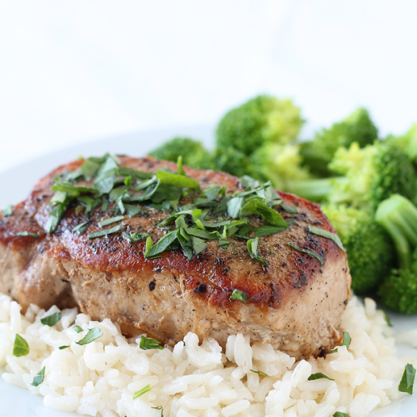 Juicy, tender pork chops with a flavorful herb rub! Such a quick and healthy dinner idea!   LoveGrowsWild.com