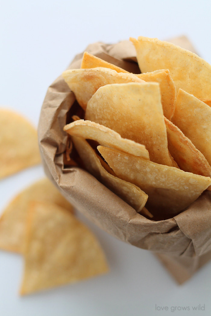 Easy, homemade Baked Tortilla Chips! Perfect for dips, salsa, and guacamole!   LoveGrowsWild.com