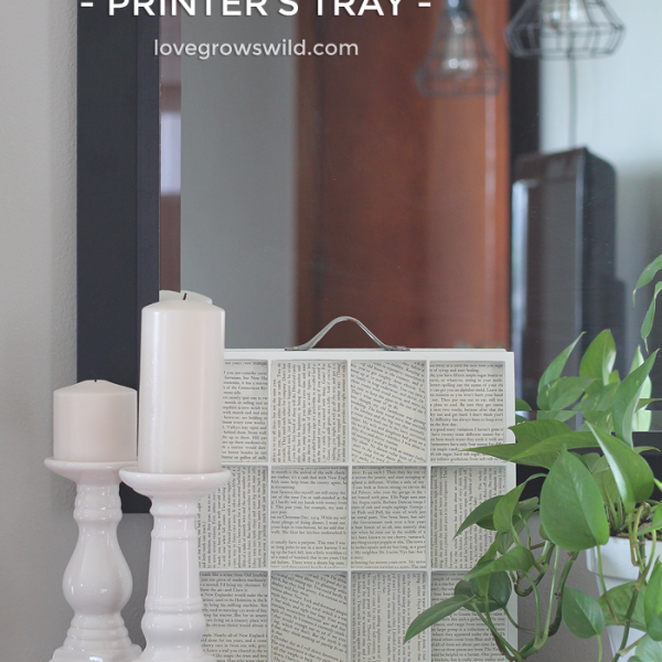 A simple printer's tray lined with old book pages makes a beautiful piece of decor! | LoveGrowsWild.com