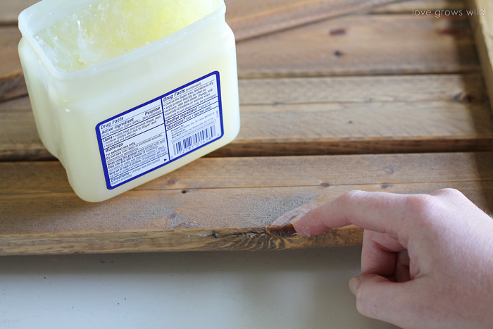 The EASY way to distress paint with Vaseline! Little effort and no sanding required!   LoveGrowsWild.com
