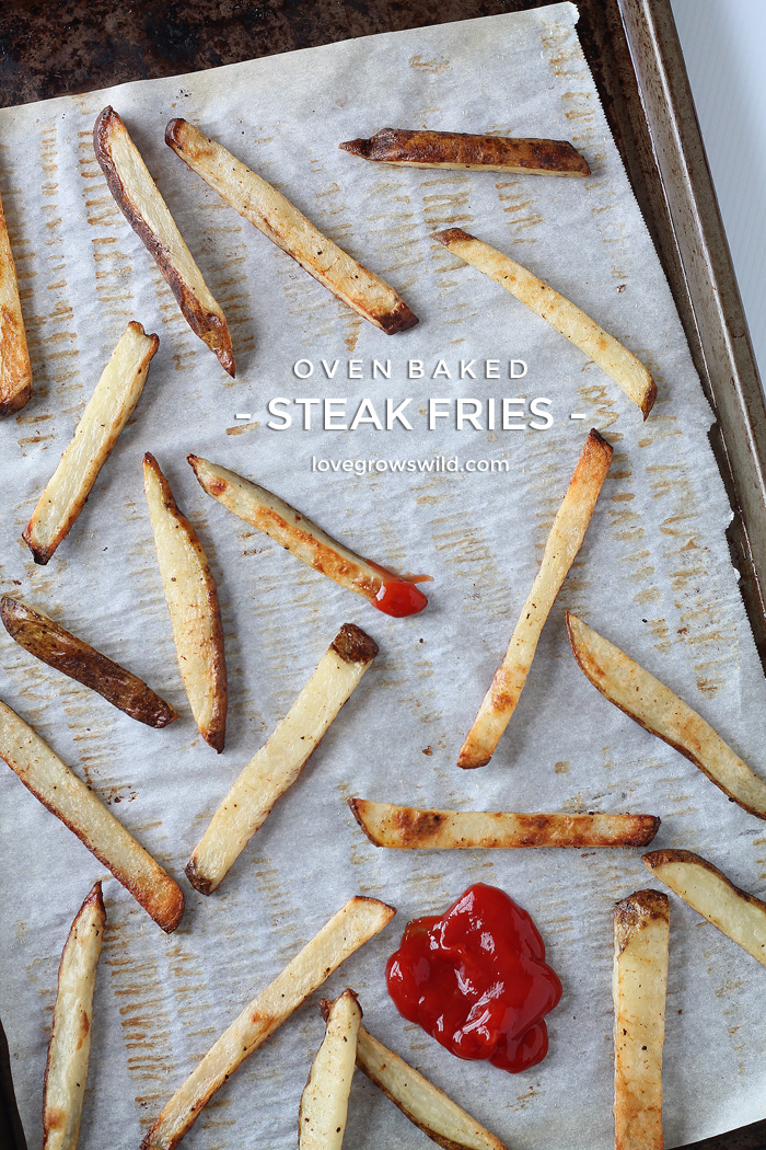 These Oven Baked Steak Fries are thick, crispy, and ready for dipping! Much healthier than fried and SO addicting! | LoveGrowsWild.com