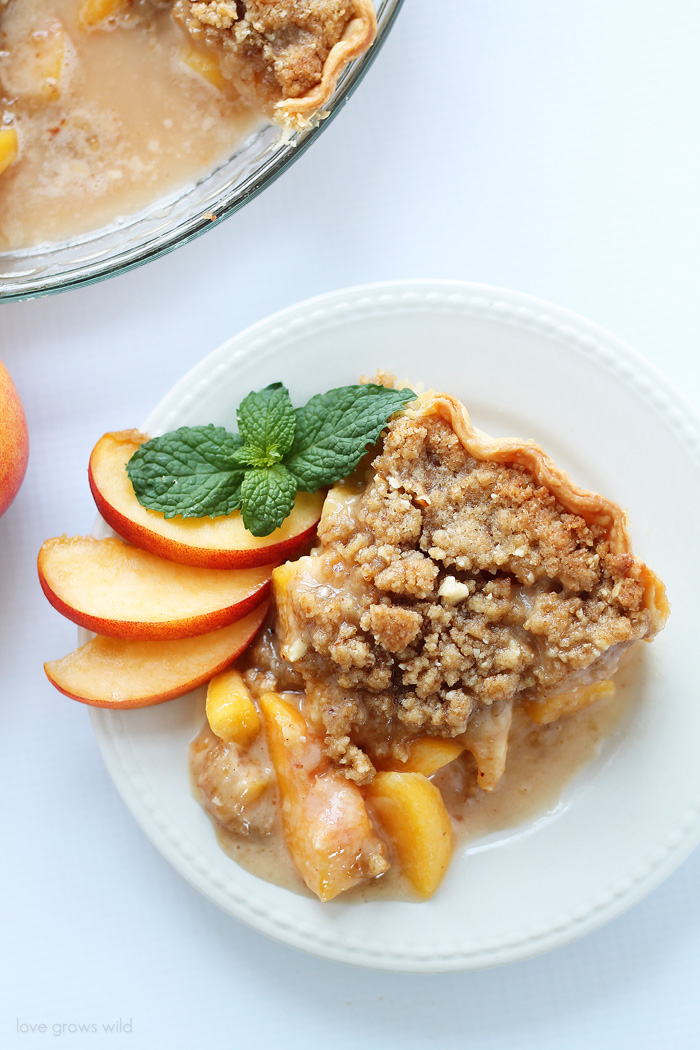 Enjoy the best flavors of summer with this perfect Peach Pie recipe topped with a delicious almond crumble!   LoveGrowsWild.com