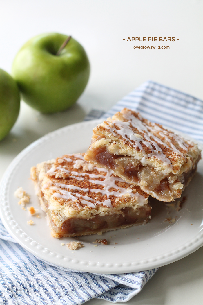 These Apple Pie Bars are the perfect handheld dessert and SO delicious! Made with fresh apples and topped with a sweet vanilla glaze! | LoveGrowsWild.com