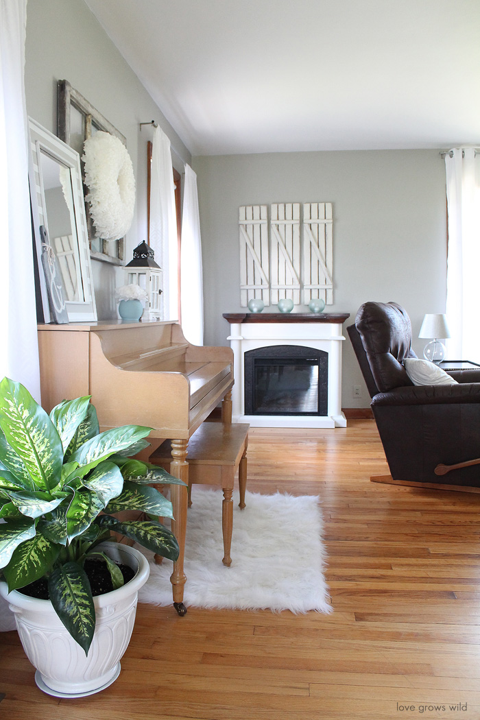 Come take a tour of this newly decorated living room with TONS of DIY projects!   LoveGrowsWild.com
