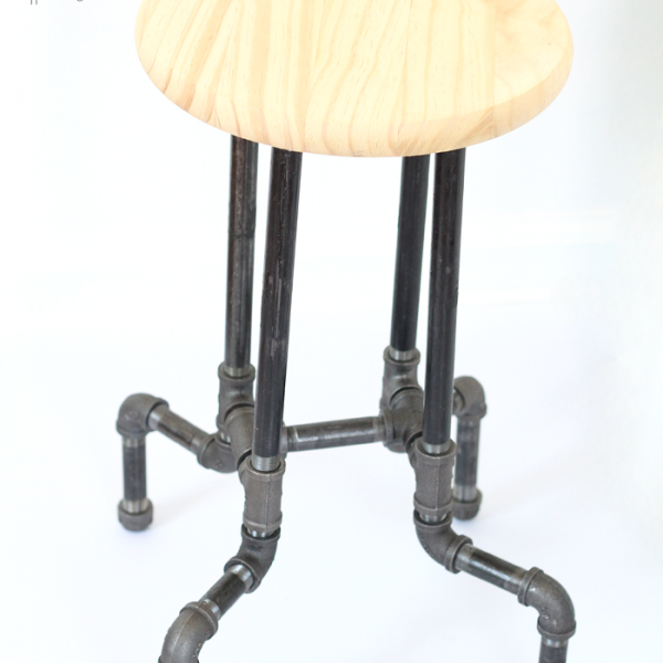 Learn how to make these awesome DIY Industrial Pipe Stools for your kitchen or office with no tools required! Click for details at LoveGrowsWild.com