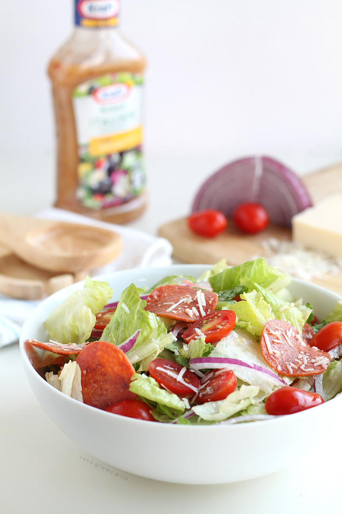 A simple, fresh Italian Salad is a great healthy meal idea! Crisp lettuce, spicy pepperoni, juicy tomatoes, and the perfect Italian dressing! | LoveGrowsWild.com