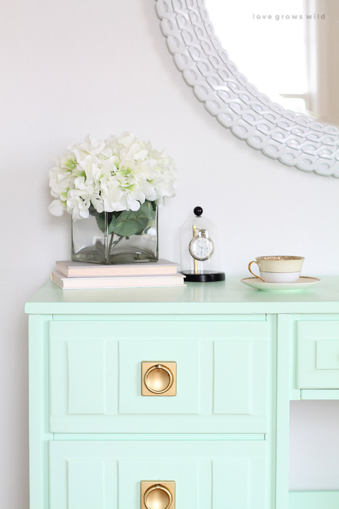 Come see how this old wood desk got a fun mint-colored makeover! Click for details at LoveGrowsWild.com