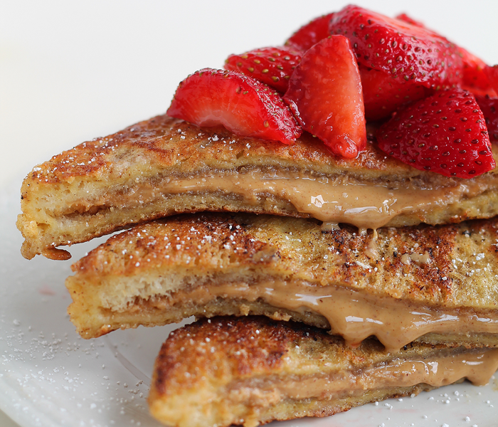 A decadent french toast recipe stuffed with creamy peanut butter and topped with fresh strawberries! This is one amazing breakfast! | LoveGrowsWild.com