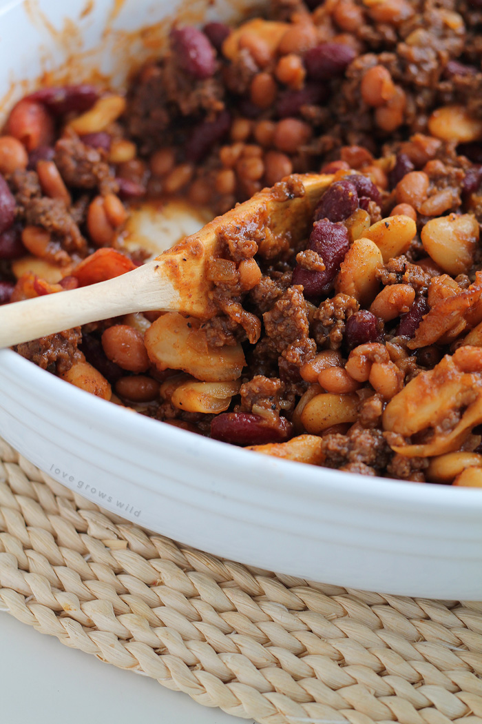 Perfect baked beans made extra meaty with ground beef and bacon! Full of flavor, easy to make, and a great side for parties, cookouts, or tailgating!   LoveGrowsWild.com