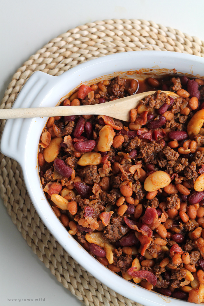 Perfect baked beans made extra meaty with ground beef and bacon! Full of flavor, easy to make, and a great side for parties, cookouts, or tailgating! | LoveGrowsWild.com