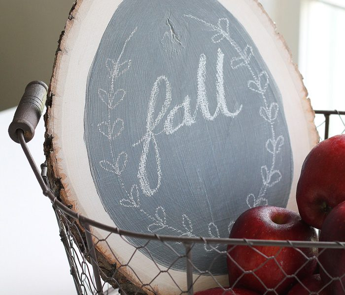 Make a simple chalkboard using a rustic wood round and some chalkboard paint! Details at LoveGrowsWild.com