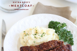 This easy meatloaf recipe is extra beefy with the addition of one delicious secret ingredient! Find out how to make the best meatloaf you have ever eaten! | LoveGrowsWild.com