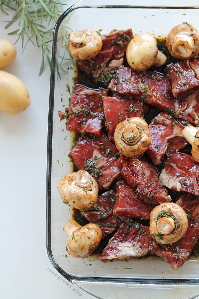 Steak, potato, and mushroom kabobs are soaked in a flavorful balsamic rosemary marinade and grilled to perfection! This takes steak and potatoes to a whole new level! | LoveGrowsWild.com