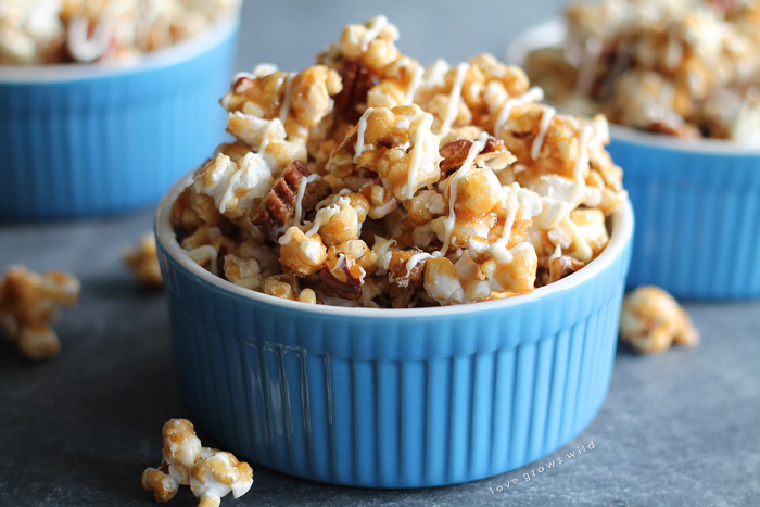 Learn how to make homemade caramel corn from scratch! It's easier than you think! Step-by-step instructions at LoveGrowsWild.com