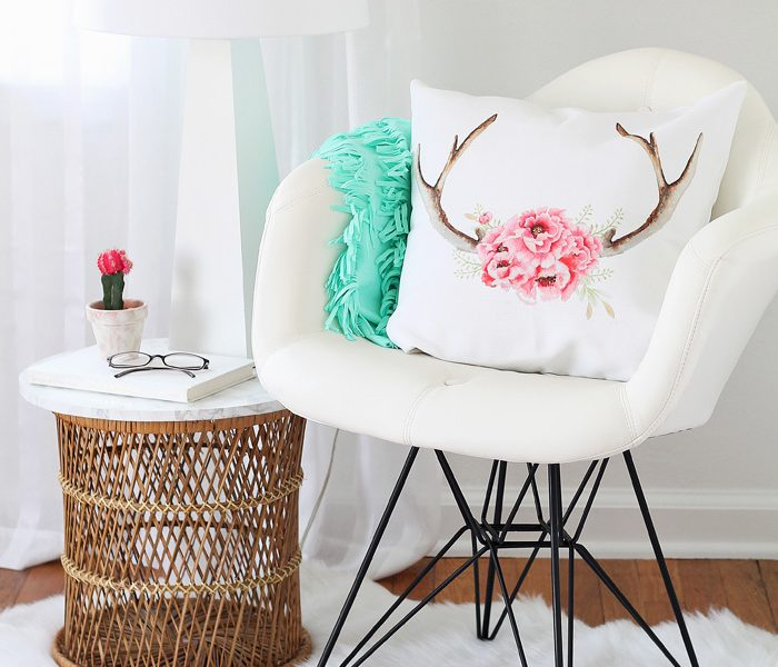 A comfy chair, faux fur rug, cute pillows, and a lamp - all you need for a cozy reading nook! See more photos of my office makeover at LoveGrowsWild.com