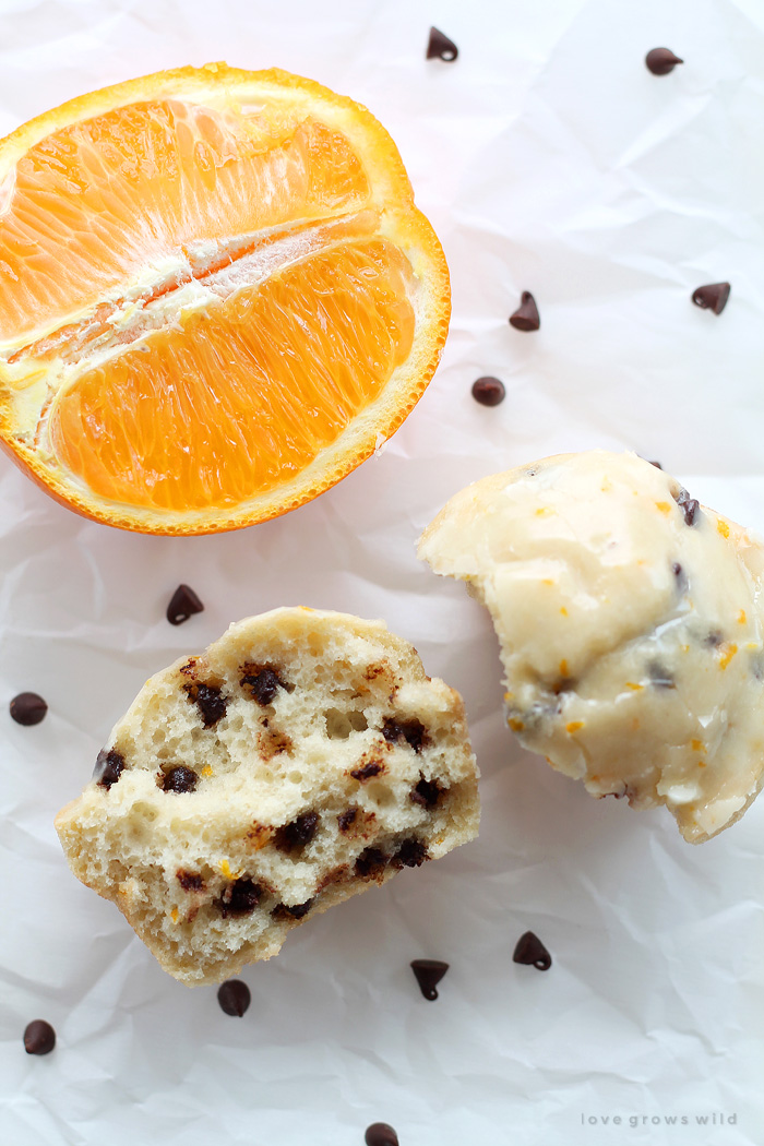 Sweet orange muffins loaded with chocolate chips and drizzled with a delicious orange glaze! The chocolate-citrus combination is so yummy and perfect for breakfast or snack time! | LoveGrowsWild.com