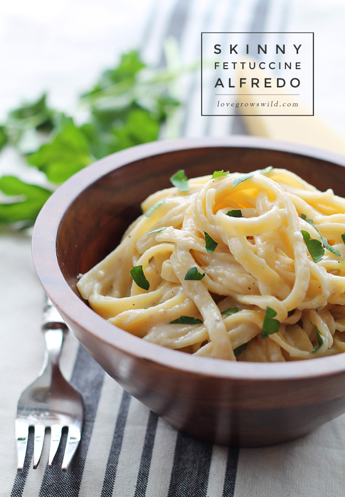 Skinny Fettuccine Alfredo - creamy, cheesy pasta that is light on calories but big on flavor! Get the recipe at LoveGrowsWild.com