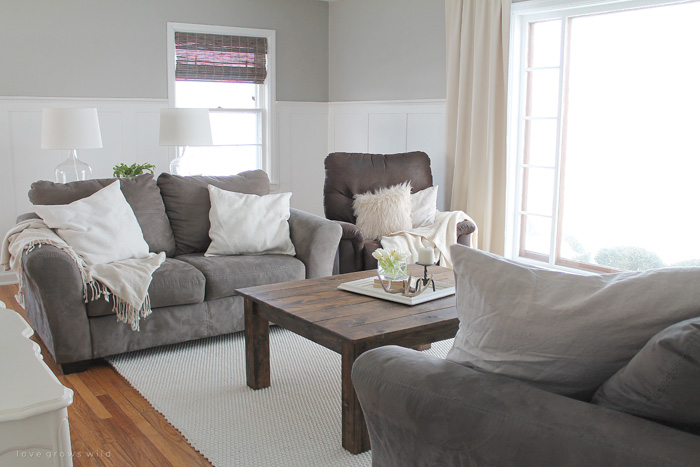 This living room is light and bright, yet rustic and cozy at the same time. Come see the transformation of this beautiful farmhouse living room! Click for more photos at LoveGrowsWild.com