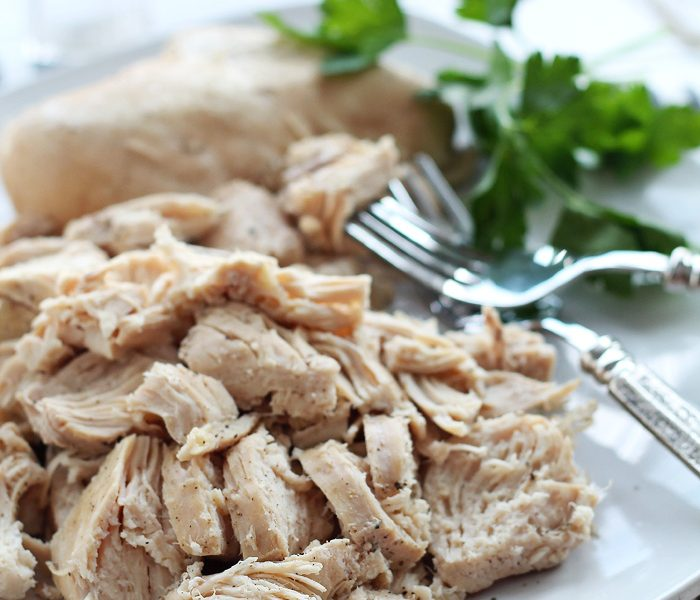 Make meal prep easier with this tender, juicy Slow Cooker Shredded Chicken! Cook the chicken ahead of time and freeze to make dinnertime a breeze on busy nights! Learn how at LoveGrowsWild.com