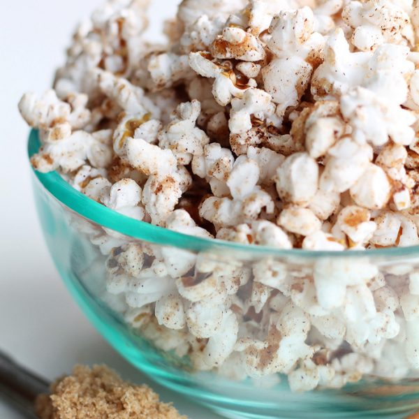 This Cinnamon Brown Sugar Popcorn is absolutely amazing! The perfect sweet snack that won't blow your diet. Get the recipe at LoveGrowsWild.com