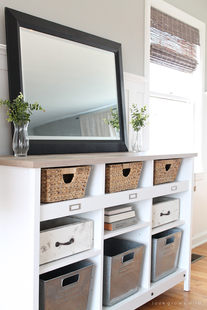 A simple storage credenza turns into functional entryway storage AND a dining room buffet. See more photos at LoveGrowsWild.com