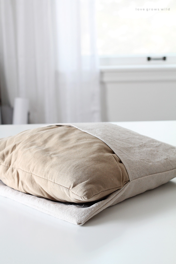 Learn how to make your own envelope pillow covers to save money and add tons of style to your space!  Details at LoveGrowsWild.com