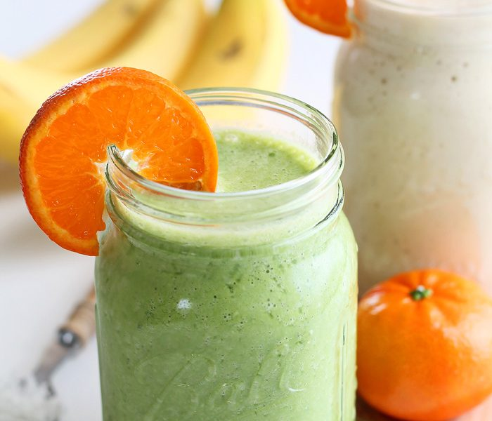 Start your day with a delicious Tropical Smoothie made with orange, banana, pineapple, and coconut! This recipe can be two ways: plain or green (with spinach)! Click to see more at LoveGrowsWild.com