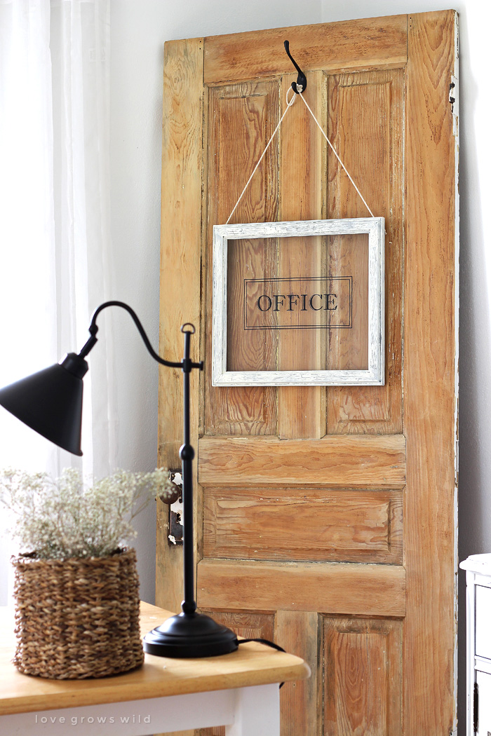 Turn any picture frame into a hanging sign! See more photos of this gorgeous farmhouse office decorated with an old door at LoveGrowsWild.com