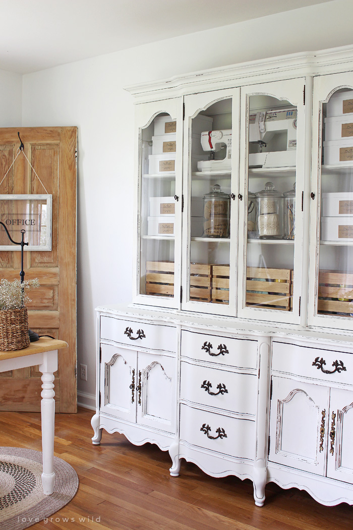 Old hutches and china cabinets make great storage for an office! See how this outdated piece gets transformed at LoveGrowsWild.com