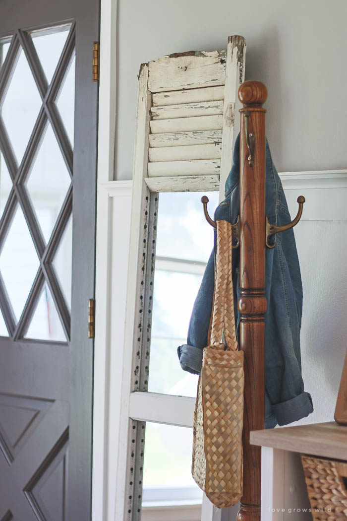 Learn how to take an old shutter and turn it into a beautiful mirror with tons of farmhouse charm!   LoveGrowsWild.com