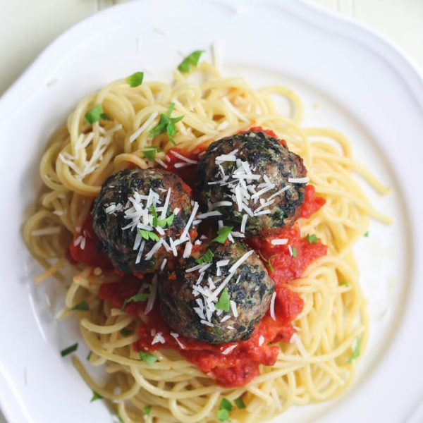 This recipe takes spaghetti and meatballs up a notch! Delicious Florentine Meatballs made with spinach and parmesan cheese are roasted in the oven then finished in a tasty marinara sauce.   LoveGrowsWild.com