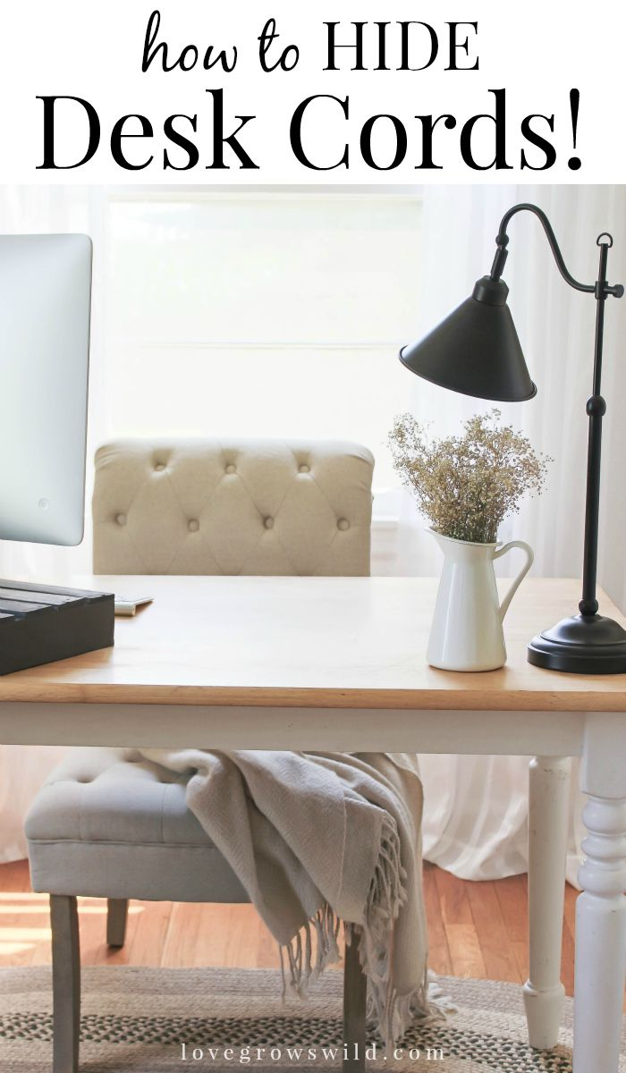 Learn how to hide annoying computer cords from LoveGrowsWild.com - perfect for when you don't want your desk shoved against a wall!