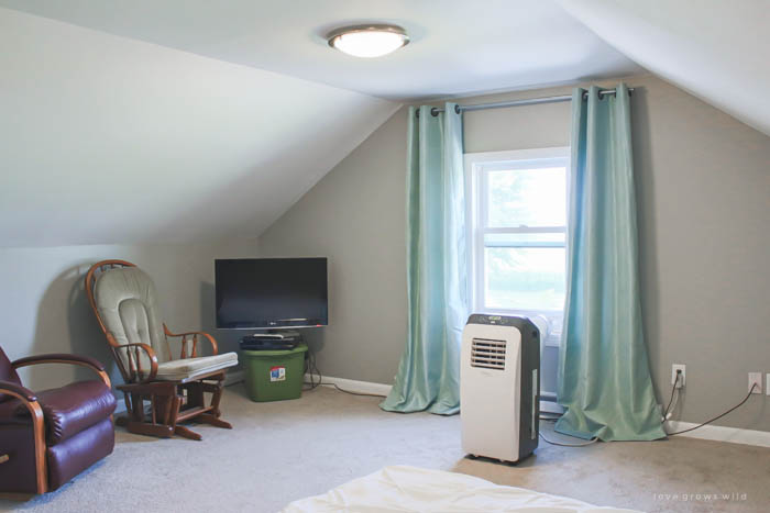 See our plans for transforming this bare, boring attic space into a cozy, farmhouse-style master bedroom! Follow along the with the makeover at LoveGrowsWild.com