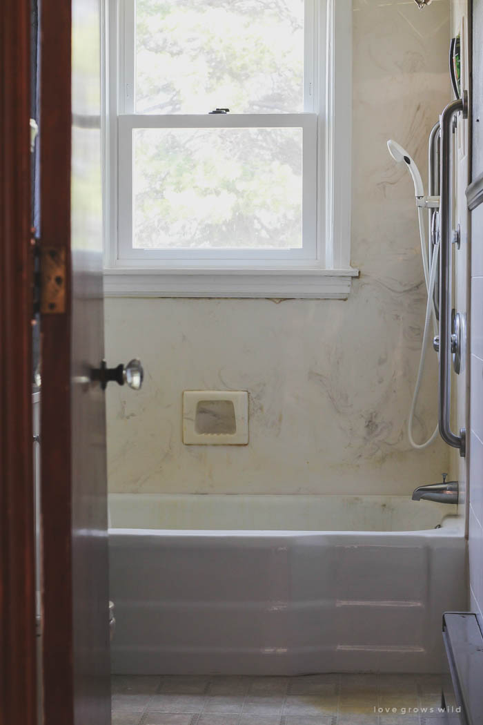 See our plans for transforming this dated, disgusting bathroom into a clean, beautiful space with a touch of farmhouse charm! Follow along with the makeover at LoveGrowsWild.com