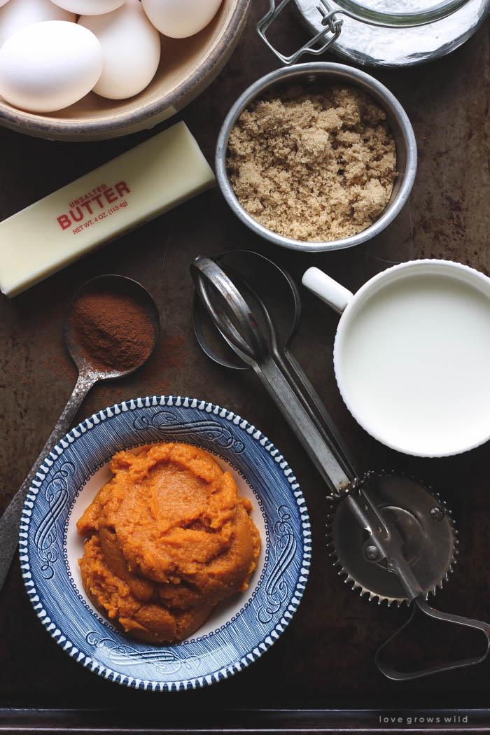 Warm, fluffy pumpkin muffins with a crunchy cinnamon sugar coating... the perfect fall breakfast, snack, or treat! | LoveGrowsWild.com