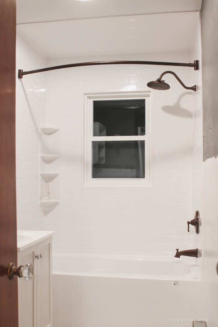 Follow along the big makeover of LoveGrowsWild.com's bathroom! In this post, Liz shares the bathtub and shower installation. Click to see more!