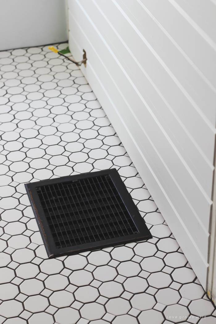 Follow along the big makeover of this beautiful farmhouse bathroom! In this post, Liz shares her tile choice for flooring. Click to see more photos at LoveGrowsWild.com