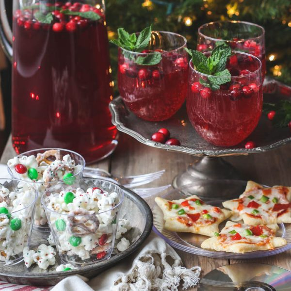 Host a holiday movie night this year! Serve these easy, festive treats during the movie: White Chocolate Popcorn Mix, Cookie Cutter Mini Pizzas, Cranberry Holiday Punch. | Recipes at LoveGrowsWild.com