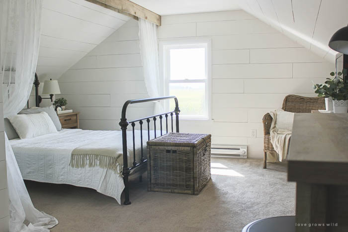 Lots of stylish, affordable furniture options in this farmhouse master bedroom! Click for more photos and details at LoveGrowsWild.com